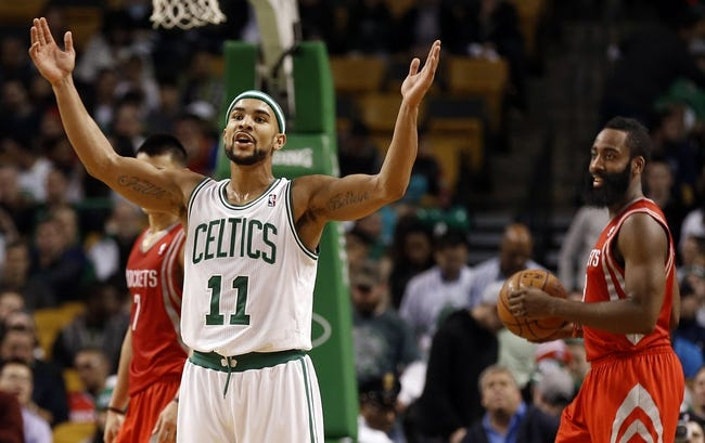 Jan 13, 2014; Boston, MA, USA; Boston Celtics point guard Jerryd Bayless (11) reacts to a foul as Houston Rockets shooting guard James Harden (13) looks on during the second half of Houston's 104-92 win at TD Garden. Mandatory Credit: Winslow Townson-USA TODAY Sports