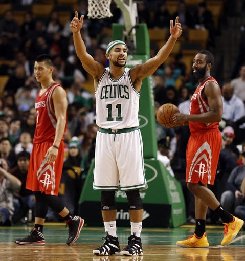 Jan 13, 2014; Boston, MA, USA; Boston Celtics point guard Jerryd Bayless (11) reacts to a foul as Houston Rockets shooting guard James Harden (13) and point guard Jeremy Lin (7) look on during the second half of Houston's 104-92 win at TD Garden. Mandatory Credit: Winslow Townson-USA TODAY Sports