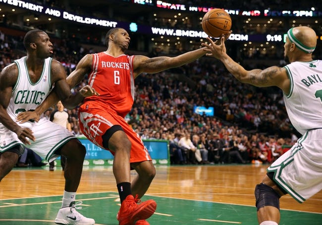 Jan 13, 2014; Boston, MA, USA; Houston Rockets power forward Terrence Jones (6) goes for a rebound between Boston Celtics power forward Brandon Bass (30) and point guard Jerryd Bayless (11) during the second half of Houston's 104-92 win  at TD Garden. Mandatory Credit: Winslow Townson-USA TODAY Sports
