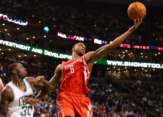 Jan 13, 2014; Boston, MA, USA; Houston Rockets power forward Terrence Jones (6) grabs a rebound over Boston Celtics power forward Brandon Bass (30) during the second half of Houston's 104-92 win  at TD Garden. Mandatory Credit: Winslow Townson-USA TODAY Sports