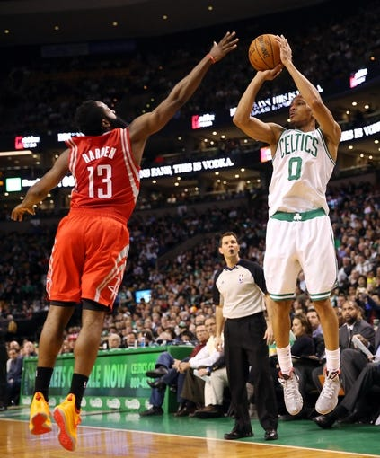 Jan 13, 2014; Boston, MA, USA; Boston Celtics point guard Avery Bradley (0) shoots over Houston Rockets shooting guard James Harden (13) during the second half of Houston's 104-92 win  at TD Garden. Mandatory Credit: Winslow Townson-USA TODAY Sports