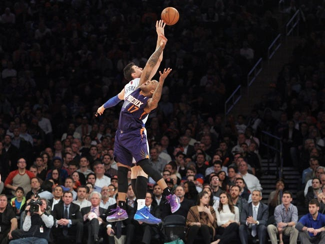 Jan 13, 2014; New York, NY, USA; New York Knicks power forward Andrea Bargnani (77) and Phoenix Suns small forward P.J. Tucker (17) jump for a rebound during the third quarter of a game at Madison Square Garden. The Knicks defeated the Suns 98-96 in overtime. Mandatory Credit: Brad Penner-USA TODAY Sports