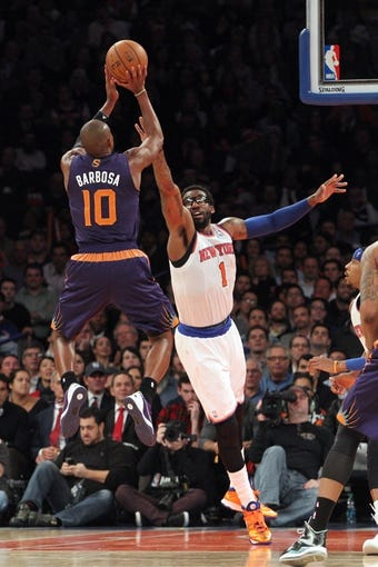 Jan 13, 2014; New York, NY, USA; Phoenix Suns shooting guard Leandro Barbosa (10) shoots over New York Knicks power forward Amar'e Stoudemire (1) during the third quarter of a game at Madison Square Garden. The Knicks defeated the Suns 98-96 in overtime. Mandatory Credit: Brad Penner-USA TODAY Sports