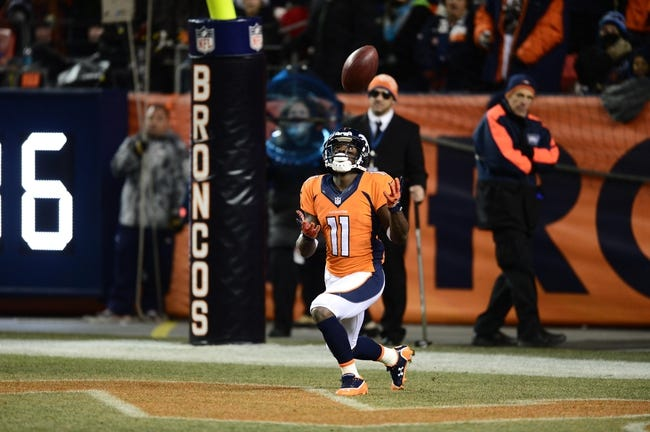 Dec 12, 2013; Denver, CO, USA; Denver Broncos wide receiver Trindon Holliday (11) attempts to catch a kick off in the fourth quarter against the San Diego Chargers at Sports Authority Field at Mile High. The San Diego Chargers defeated the Denver Broncos 27-20. Mandatory Credit: Ron Chenoy-USA TODAY Sports