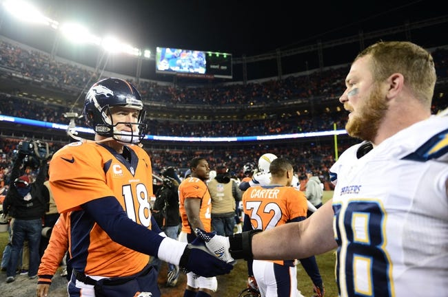 Dec 12, 2013; Denver, CO, USA; Denver Broncos quarterback Peyton Manning (18) shakes hands with San Diego Chargers defensive end Sean Lissemore (98) following the game at Sports Authority Field at Mile High. The San Diego Chargers defeated the Denver Broncos 27-20. Mandatory Credit: Ron Chenoy-USA TODAY Sports