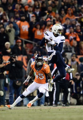 Dec 12, 2013; Denver, CO, USA; Denver Broncos cornerback Dominique Rodgers-Cromartie (45) defends a reception by San Diego Chargers wide receiver Keenan Allen (13) in the second quarter against the San Diego Chargers at Sports Authority Field at Mile High. Mandatory Credit: Ron Chenoy-USA TODAY Sports