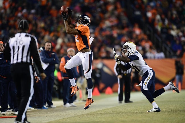 Dec 12, 2013; Denver, CO, USA; Denver Broncos wide receiver Andre Caldwell (12) makes a reception in front of San Diego Chargers cornerback Richard Marshall (31) in the second quarter at Sports Authority Field at Mile High. Mandatory Credit: Ron Chenoy-USA TODAY Sports