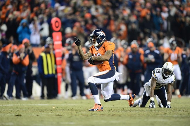Dec 12, 2013; Denver, CO, USA; Denver Broncos wide receiver Andre Caldwell (12) reacts to his first down reception next to San Diego Chargers cornerback Shareece Wright (29) in the fourth quarter at Sports Authority Field at Mile High. The San Diego Chargers defeated the Denver Broncos 27-20. Mandatory Credit: Ron Chenoy-USA TODAY Sports