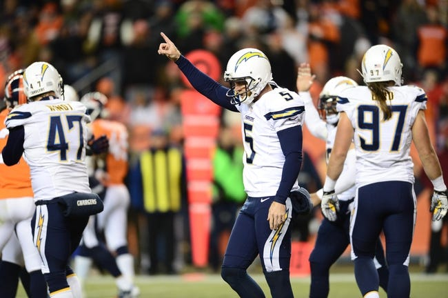 Dec 12, 2013; Denver, CO, USA; San Diego Chargers punter Mike Scifres (5) reacts to a penalty called on Denver Broncos outside linebacker Nate Irving (not pictured) resulting in a first down at Sports Authority Field at Mile High. The San Diego Chargers defeated the Denver Broncos 27-20. Mandatory Credit: Ron Chenoy-USA TODAY Sports