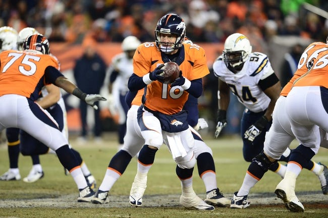 Dec 12, 2013; Denver, CO, USA; Denver Broncos quarterback Peyton Manning (18) prepares to hand off in the fourth quarter against the San Diego Chargers at Sports Authority Field at Mile High. The San Diego Chargers defeated the Denver Broncos 27-20. Mandatory Credit: Ron Chenoy-USA TODAY Sports