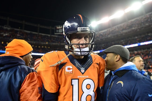 Dec 12, 2013; Denver, CO, USA; Denver Broncos quarterback Peyton Manning (18) leaves the field following the loss to the San Diego Chargers at Sports Authority Field at Mile High. The San Diego Chargers defeated the Denver Broncos 27-20. Mandatory Credit: Ron Chenoy-USA TODAY Sports