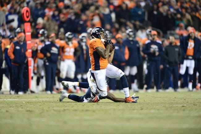 Dec 12, 2013; Denver, CO, USA; Denver Broncos wide receiver Andre Caldwell (12) pulls in a reception  as San Diego Chargers cornerback Shareece Wright (29) defends in the fourth quarter at Sports Authority Field at Mile High. The San Diego Chargers defeated the Denver Broncos 27-20. Mandatory Credit: Ron Chenoy-USA TODAY Sports