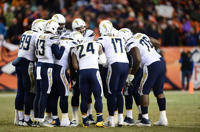 Dec 12, 2013; Denver, CO, USA; San Diego Chargers quarterback Philip Rivers (17) huddles with wide receiver Keenan Allen (13) and tight end Ladarius Green (89) and tight end Antonio Gates (85) and guard Chad Rinehart (78) and offensive tackle D.J. Fluker (76) in the fourth quarter against the Denver Broncos at Sports Authority Field at Mile High. The San Diego Chargers defeated the Denver Broncos 27-20. Mandatory Credit: Ron Chenoy-USA TODAY Sports