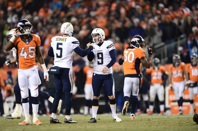 Dec 12, 2013; Denver, CO, USA; San Diego Chargers kicker Nick Novak (9) is congratulated for a field goal by punter Mike Scifres (5) in the fourth quarter against the Denver Broncos at Sports Authority Field at Mile High. The San Diego Chargers defeated the Denver Broncos 27-20. Mandatory Credit: Ron Chenoy-USA TODAY Sports