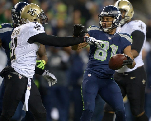 Dec 2, 2013; Seattle, WA, USA; New Orleans Saints safety Roman Harper (41) shoves Seattle Seahawks receiver Golden Tate (81) in the first quarter at CenturyLink Field. Mandatory Credit: Kirby Lee-USA TODAY Sports