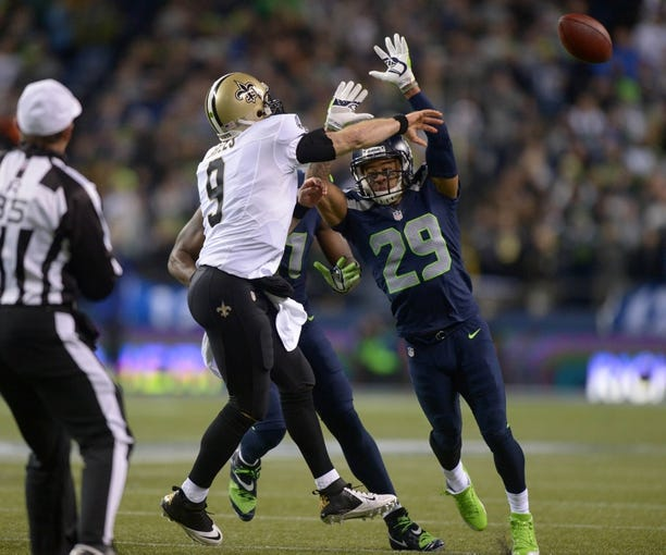 Dec 2, 2013; Seattle, WA, USA; New Orleans Saints quarterback Drew Brees (9) throws a pass under pressure from Seattle Seahawks safety Earl Thomas (29) at CenturyLink Field. The Seahawks defeated the Saints 34-7. Mandatory Credit: Kirby Lee-USA TODAY Sports