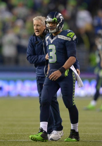 Dec 2, 2013; Seattle, WA, USA; Seattle Seahawks coach Pete Carroll (left) and quarterback Russell Wilson (3) during the game against the New Orleans Saints at CenturyLink Field. The Seahawks defeated the Saints 34-7. Mandatory Credit: Kirby Lee-USA TODAY Sports