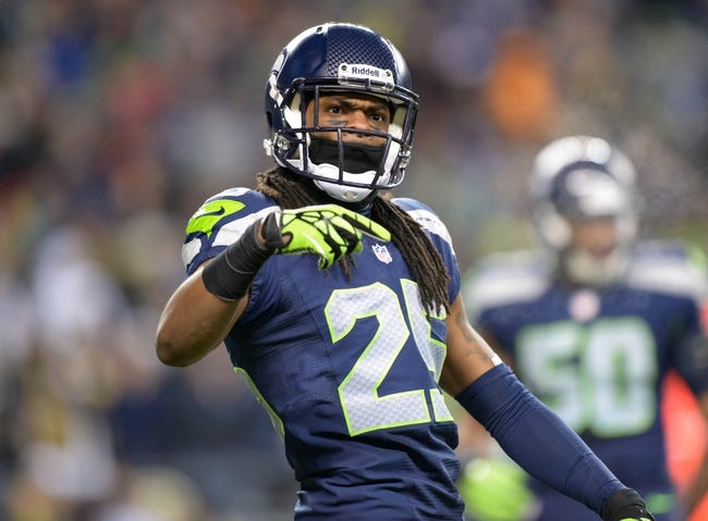 Dec 2, 2013; Seattle, WA, USA; Seattle Seahawks cornerback Richard Sherman (25) celebrates during the game against the New Orleans Saints at CenturyLink Field. The Seahawks defeated the Saints 34-7. Mandatory Credit: Kirby Lee-USA TODAY Sports