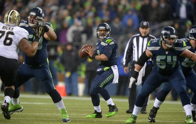 Dec 2, 2013; Seattle, WA, USA; Seattle Seahawks quarterback Russell Wilson (3) throws a pass against the New Orleans Saints at CenturyLink Field. Mandatory Credit: Kirby Lee-USA TODAY Sports