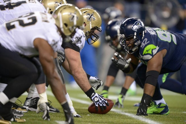 Dec 2, 2013; Seattle, WA, USA; General view of the line of scrimmage as New Orleans Saints center Brian de la Puente (60) snaps the ball against Seattle Seahawks defensive tackle Brandon Mebane (92) at CenturyLink Field. The Seahawks defeated the Saints 34-7. Mandatory Credit: Kirby Lee-USA TODAY Sports