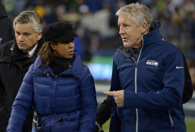 Dec 2, 2013; Seattle, WA, USA; ESPN sideline reporter Lisa Salters (left) interviews Seattle Seahawks coach Pete Carroll during the game against the New Orleans Saints at CenturyLink Field. The Seahawks defeated the Saints 34-7. Mandatory Credit: Kirby Lee-USA TODAY Sports