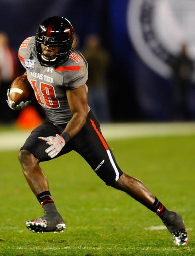 Dec 30, 2013; San Diego, CA, USA; Texas Tech Red Raiders receiver Eric Ward (18) runs after a reception against the Arizona State Sun Devils during the first half in the Holiday Bowl at Qualcomm Stadium. Mandatory Credit: Christopher Hanewinckel-USA TODAY Sports
