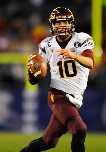 Dec 30, 2013; San Diego, CA, USA; Arizona State Sun Devils quarterback Taylor Kelly (10) looks to pass the ball during the second half against the Texas Tech Red Raiders in the Holiday Bowl at Qualcomm Stadium. Mandatory Credit: Christopher Hanewinckel-USA TODAY Sports