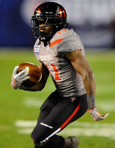 Dec 30, 2013; San Diego, CA, USA; Texas Tech Red Raiders receiver Jakeem Grant (11) runs after a reception against the Arizona State Sun Devils during the first half in the Holiday Bowl at Qualcomm Stadium. Mandatory Credit: Christopher Hanewinckel-USA TODAY Sports