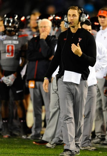 Dec 30, 2013; San Diego, CA, USA; Texas Tech Red Raiders head coach Kliff Kingsbury calls in a play during the second half against the Arizona State Sun Devils in the Holiday Bowl at Qualcomm Stadium. Mandatory Credit: Christopher Hanewinckel-USA TODAY Sports