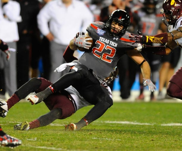 Dec 30, 2013; San Diego, CA, USA; Texas Tech Red Raiders tight end Jace Amaro (22) is tackled after a reception during the second half against the Arizona State Sun Devils in the Holiday Bowl at Qualcomm Stadium. Mandatory Credit: Christopher Hanewinckel-USA TODAY Sports