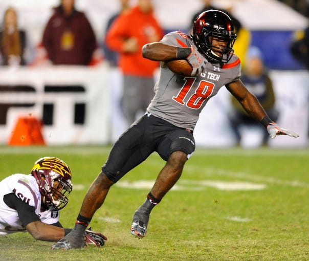 Dec 30, 2013; San Diego, CA, USA; Texas Tech Red Raiders receiver Eric Ward (18) gets away from a defender during the second half against the Arizona State Sun Devils in the Holiday Bowl at Qualcomm Stadium. Texas Tech won 37-23. Mandatory Credit: Christopher Hanewinckel-USA TODAY Sports