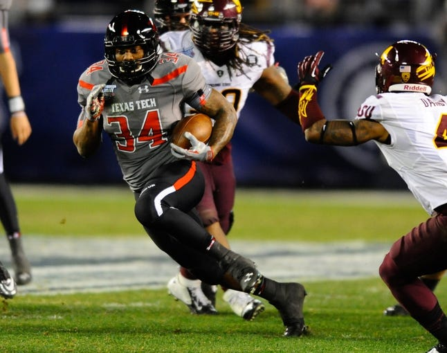 Dec 30, 2013; San Diego, CA, USA; Texas Tech Red Raiders running back Kenny Williams (34) runs for a first down against the Arizona State Sun Devils during the first half in the Holiday Bowl at Qualcomm Stadium. Mandatory Credit: Christopher Hanewinckel-USA TODAY Sports