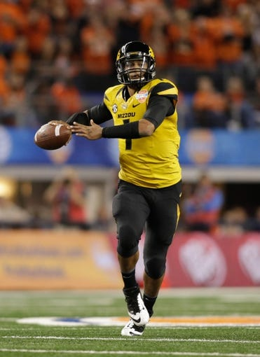 Jan 3, 2014; Arlington, TX, USA; Missouri Tigers quarterback James Franklin (1) throws a pass in the first quarter against the Oklahoma State Cowboys at the 2014 Cotton Bowl at AT&T Stadium. Missouri beat Oklahoma State 41-31.  Mandatory Credit: Tim Heitman-USA TODAY Sports