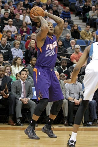 Jan 8, 2014; Minneapolis, MN, USA; Phoenix Suns forward P.J. Tucker (17) against the Minnesota Timberwolves at Target Center. The Suns defeated the Timberwolves 104-103. Mandatory Credit: Brace Hemmelgarn-USA TODAY Sports