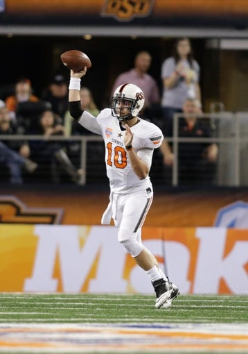 Jan 3, 2014; Arlington, TX, USA; Oklahoma State Cowboys quarterback Clint Chelf (10) throws a pass in the game against the Missouri Tigers at the 2014 Cotton Bowl at AT&T Stadium. Missouri beat Oklahoma State 41-31. Mandatory Credit: Tim Heitman-USA TODAY Sports