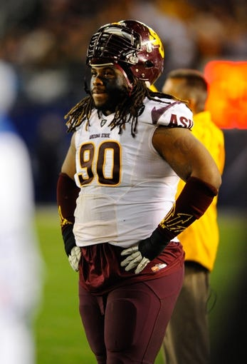 Dec 30, 2013; San Diego, CA, USA; Arizona State Sun Devils defensive tackle Will Sutton (90) looks on from the sideline during the second half against the Texas Tech Red Raiders in the Holiday Bowl at Qualcomm Stadium. Mandatory Credit: Christopher Hanewinckel-USA TODAY Sports