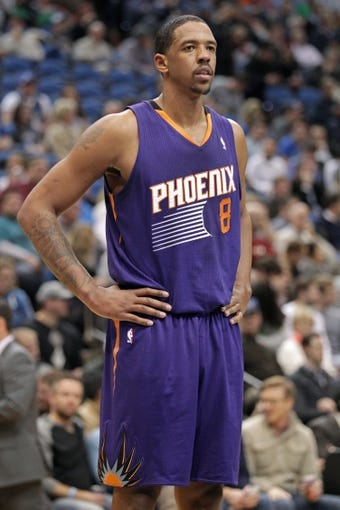 Jan 8, 2014; Minneapolis, MN, USA; Phoenix Suns forward Channing Frye (8) against the Minnesota Timberwolves at Target Center. The Suns defeated the Timberwolves 104-103. Mandatory Credit: Brace Hemmelgarn-USA TODAY Sports
