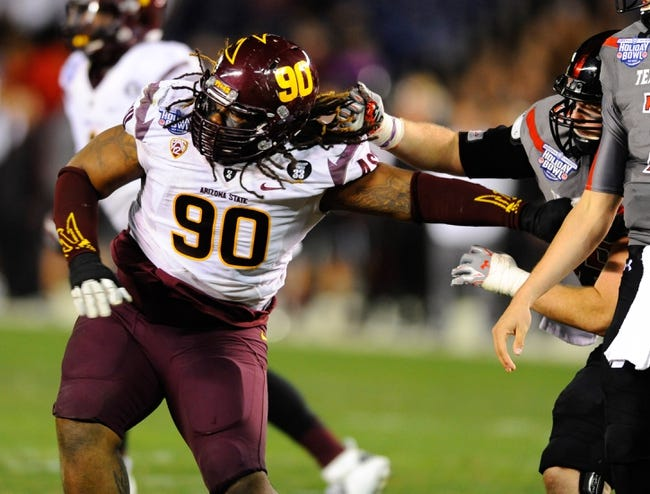 Dec 30, 2013; San Diego, CA, USA; Arizona State Sun Devils defensive tackle Will Sutton (90) rushes the quarterback during the first half against the Texas Tech Red Raiders during the first half in the Holiday Bowl at Qualcomm Stadium. Mandatory Credit: Christopher Hanewinckel-USA TODAY Sports