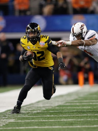 Jan 3, 2014; Arlington, TX, USA; Missouri Tigers running back Russell Hansbrough (32) runs the ball against the Oklahoma State Cowboys at the 2014 Cotton Bowl at AT&T Stadium. Missouri beat Oklahoma State 41-31. Mandatory Credit: Tim Heitman-USA TODAY Sports