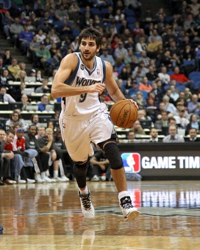 Jan 8, 2014; Minneapolis, MN, USA; Minnesota Timberwolves guard Ricky Rubio (9) against the Phoenix Suns at Target Center. The Suns defeated the Timberwolves 104-103. Mandatory Credit: Brace Hemmelgarn-USA TODAY Sports