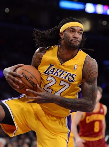 Jan 14, 2014; Los Angeles, CA, USA; Los Angeles Lakers center Jordan Hill (27) grabs a rebound in the first half of the game against the Cleveland Cavaliers at Staples Center. Mandatory Credit: Jayne Kamin-Oncea-USA TODAY Sports