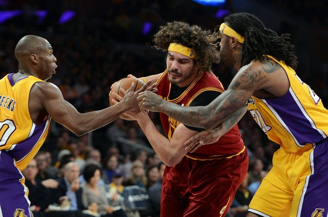 Jan 14, 2014; Los Angeles, CA, USA; Los Angeles Lakers shooting guard Jodie Meeks (20) and center Jordan Hill (27) guard Cleveland Cavaliers center Anderson Varejao (17) in the first half of the game at Staples Center. Mandatory Credit: Jayne Kamin-Oncea-USA TODAY Sports