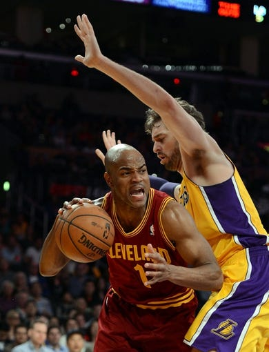Jan 14, 2014; Los Angeles, CA, USA; Los Angeles Lakers center Pau Gasol (16) guards Cleveland Cavaliers point guard Jarrett Jack (1) in the first half of the game at Staples Center. Mandatory Credit: Jayne Kamin-Oncea-USA TODAY Sports