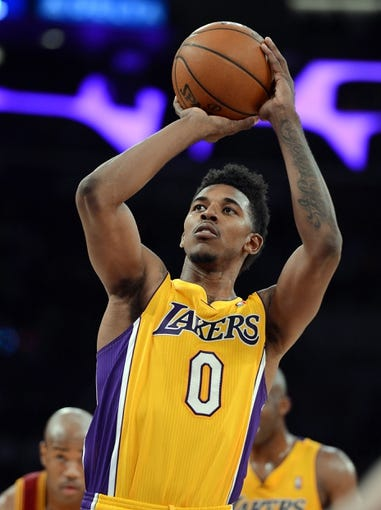 Jan 14, 2014; Los Angeles, CA, USA; Los Angeles Lakers small forward Nick Young (0) in the second half of the game against the Cleveland Cavaliers at Staples Center. Cleveland Cavaliers won 120-118. Mandatory Credit: Jayne Kamin-Oncea-USA TODAY Sports