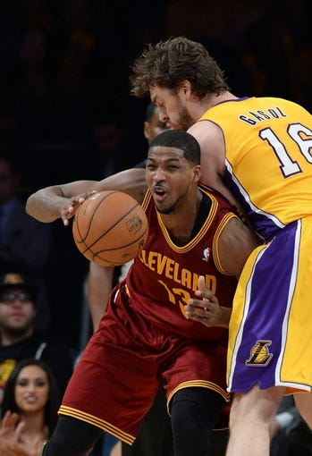 Jan 14, 2014; Los Angeles, CA, USA;   Los Angeles Lakers center Pau Gasol (16) guards Cleveland Cavaliers power forward Tristan Thompson (13) in the second half of the game at Staples Center. Cleveland Cavaliers won 120-118. Mandatory Credit: Jayne Kamin-Oncea-USA TODAY Sports
