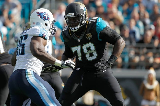 Dec 22, 2013; Jacksonville, FL, USA; Jacksonville Jaguars tackle Cameron Bradfield (78) blocks against the Tennessee Titans during the first quarter at EverBank Field. Mandatory Credit: Kim Klement-USA TODAY Sports