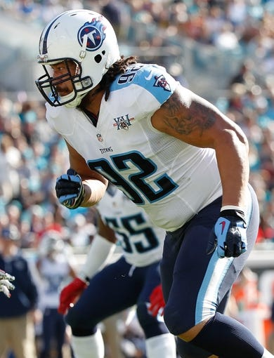 Dec 22, 2013; Jacksonville, FL, USA; Tennessee Titans defensive end Ropati Pitoitua (92) rushes against the Jacksonville Jaguars during the first half at EverBank Field. Mandatory Credit: Kim Klement-USA TODAY Sports