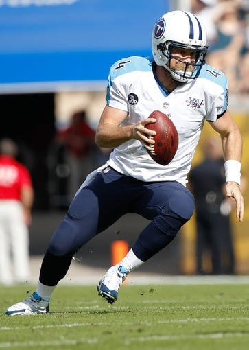 Dec 22, 2013; Jacksonville, FL, USA; Tennessee Titans quarterback Ryan Fitzpatrick (4) runs out of the pocket against the Jacksonville Jaguars during the first quarter at EverBank Field. Mandatory Credit: Kim Klement-USA TODAY Sports