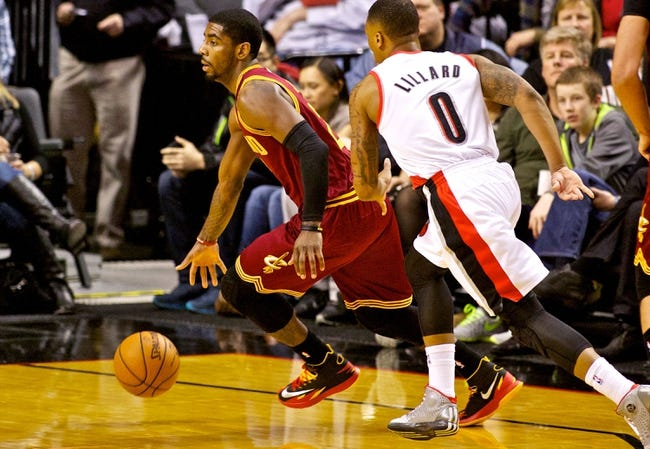 Jan 15, 2014; Portland, OR, USA; Cleveland Cavaliers point guard Kyrie Irving (2) drives past Portland Trail Blazers point guard Damian Lillard (0) at the Moda Center. Mandatory Credit: Craig Mitchelldyer-USA TODAY Sports