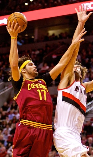 Jan 15, 2014; Portland, OR, USA; Cleveland Cavaliers center Anderson Varejao (17) shoots over Portland Trail Blazers center Robin Lopez (42) at the Moda Center. Mandatory Credit: Craig Mitchelldyer-USA TODAY Sports